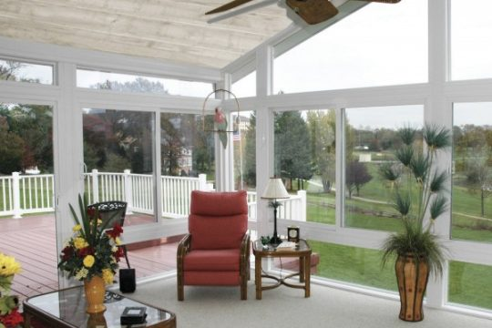sunroom with wood plank ceiling