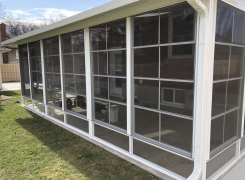 Sunroom With 4 Track Windows
