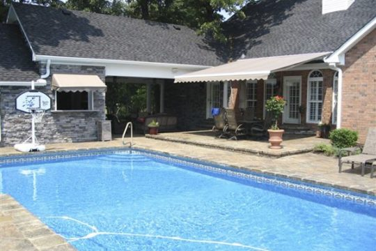 Retractable Awning and Window Awning by Pool