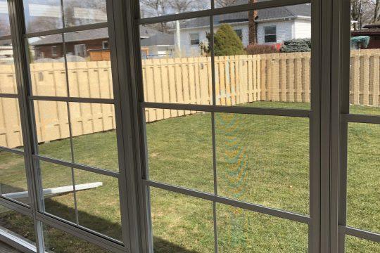 Sunroom With 4 Track Windows